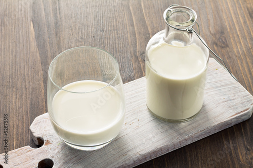 Milk on wooden background