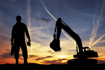 Bulldozer silhouette at sunset