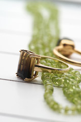 Mixed jewelry -green peridot necklace and gold rings