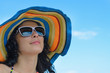 Stunning woman in a colourful straw sun hat