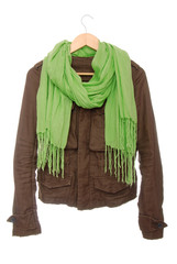 Brown jacket and green scarf are on hanger.