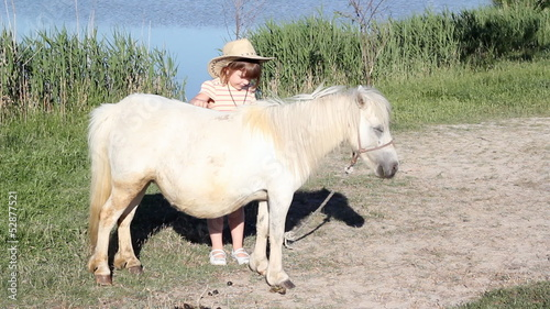 white pony horse and little girl