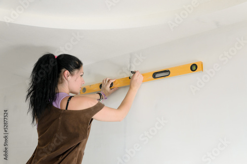 Woman using a spirit level