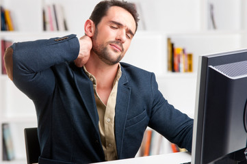 Casual Businessman With Pain In His Neck
