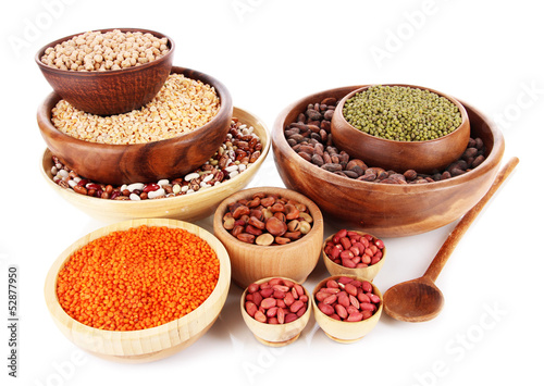 Different kinds of beans in bowls isolated on white
