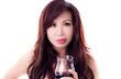 Beautiful Asian woman holds wineglass