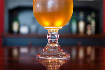 Goblet of refreshing golden beer