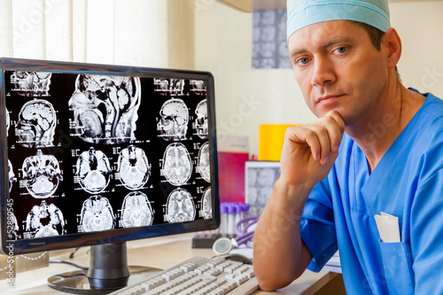 Experienced doctor with an MRI scan