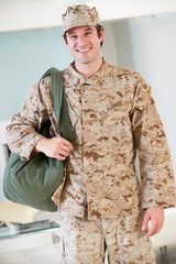 Male Soldier With Kit Bag Home For Leave