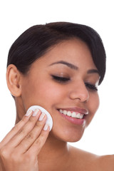 Young Woman Wiping Face With A Pad