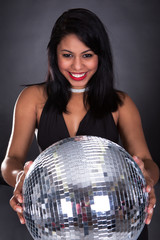 Young Woman Holding Disco Ball