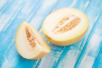 Sliced Galia melon on wooden boards, horizontal shot