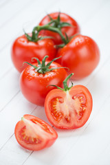Vertical shot of fresh red tomatoes, close-up