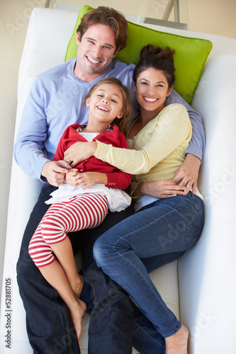 Overhead View Of Family Relaxing On Sofa