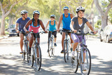 Fototapety Group Of Cyclists On Suburban Street