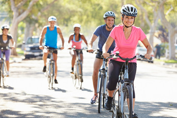 Group Of Cyclists On Suburban Street