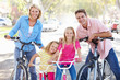 canvas print picture - Family Cycling On Suburban Street