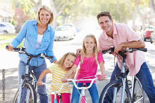 canvas print picture Family Cycling On Suburban Street