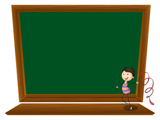 A girl dancing in front of an empty blackboard