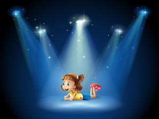 A cute little girl at the stage with spotlights