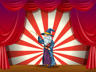A wizard holding a wand in the middle of the stage