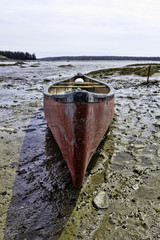 Used canoe at low tide