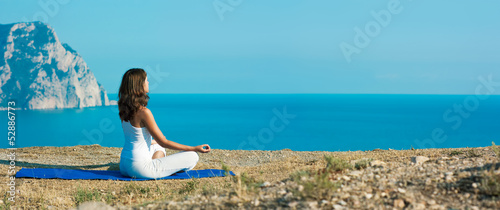 Woman Doing Yoga near the Ocean
