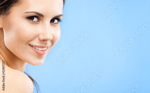 Portrait of beautiful woman, on blue