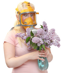 Allergy to pollen concept. Young woman in protection mask.