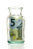 five euro inside glass jar