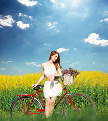 Girl on a bike in the countryside.