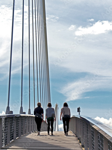 3 girls on bridge