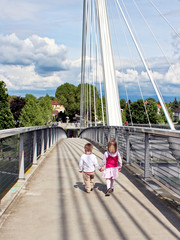 cute children couple on bridge