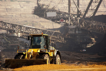 A bulldozer and a very large bucket wheel excavator