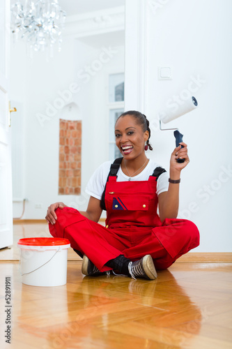 Woman in her home renovating diy