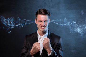 Businessman smoking with anger