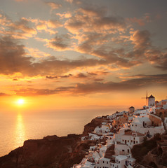 Santorini with sunset over sea in Greece, Oia village