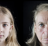 Old woman and young girl face closeup