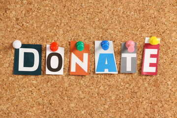 The word Donate on a Cork Notice Board