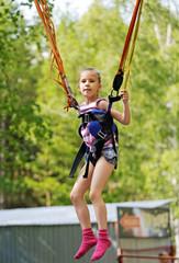 Girl jumping on a trampoline kangaroo