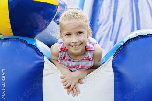 Delighted girl on roller coaster