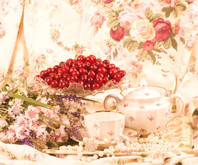 Vintage tea in elegant tableware, cherry and flowers