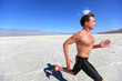 Running sport man - fitness runner in desert