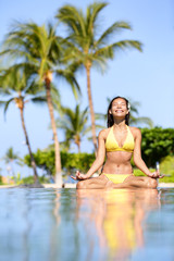 Serene meditating woman relaxing at luxury travel