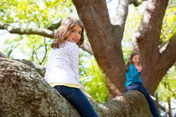 kid children girls playing riding a tree branch
