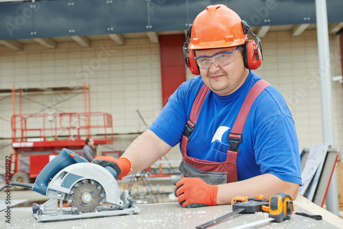 Portrait of builder worker at construction site