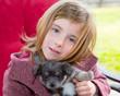 Blond girl hug a gray pyppy chihuahua dog