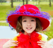 funny little girl with fashion red hat and tulle bow