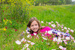 Happy relaxed kid girl on a spring flowers meadow