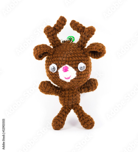 handmade crochet brown deer doll on white background